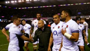 Eddie Jones consoles his players/Getty