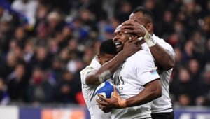 Fiji celebrate their win over France