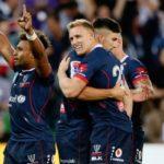 Melbourne Rebels backline celebrates