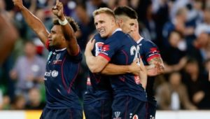 Melbourne Rebels backline celebrates